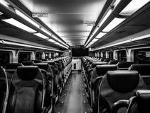 Dover, NJ USA - November 1, 2017:  NJ Transit train at night with empty seats, black and white Stock Photos