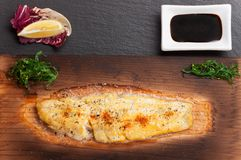 Dover sole. On a grilling plank Stock Images
