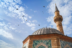 Doves fly over Ancient Camii mosque, Izmir. Doves fly over Ancient Camii mosque. Konak square, Izmir, Turkey Stock Images