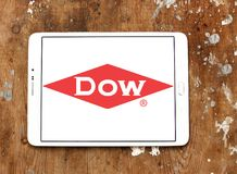 Dow Chemical Company logo. Logo of Dow Chemical Company on samsung tablet on wooden background. Dow Chemical is an american multinational chemical corporation Royalty Free Stock Photography
