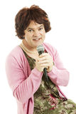 Dowdy Middle-aged Singer. Female impersonator dressed as an unattractive middle-aged singer.  Isolated on white Stock Photos