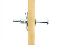 Dowel and construction. Dowel and building in the work on a white background closeup royalty free stock image