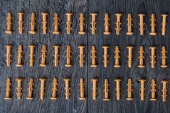 Dowels on wooden background Royalty Free Stock Images