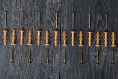 Dowels on wooden background Royalty Free Stock Image