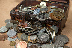 Dower chest with old coins Royalty Free Stock Photography