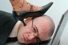Down. Female shoe over men head Royalty Free Stock Images