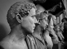 Down the Ages. Receeding shot of busts show the progress of history, generations, families and art styles royalty free stock photos