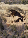 Down Below. Ruins of an Anasazi Cliff Dwelling below the mesa surface in the Colorado desert stock photo
