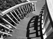 Down circular staircase. Black and white image of a Victorian style house circular staircase Royalty Free Stock Images