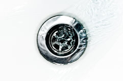 Down the drain stock images