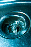Down the drain stock image