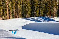 Down with drugs! Snowboarder falls into the pipe at Mammoth Mountain, California USA. Metaphor for drugs going down. amateur snowboarder fall in the mini half Stock Photos