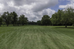 Down the Fairway. A look down the Fairway of a beautiful golf course Royalty Free Stock Image