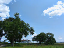 Down On the Farm Landscape. This is an old abandoned farm on a lovely summer day with blue skies and fluffy white clouds stock photo