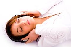 down floor lying music to tuned woman Στοκ Εικόνα