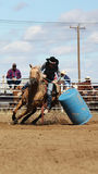 Down she goes. Barrel racing at the rodeo with a down barrel Royalty Free Stock Photography