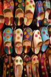 Moroccan shoes on rack in shop royalty free stock photography