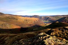 Down High Hartsop Dodd to Hartsop. Autumn sunlight on the Ullswater fells Royalty Free Stock Image