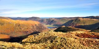 Down High Hartsop Dodd to Hartsop. Autumn sunlight on the Ullswater fells Stock Photos