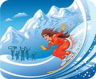 Down from the hill. Young lady moving fast down from mountain slope on her snowboard Stock Photography