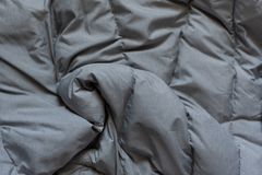 Down jacket fabric background, gray puffer jacket texture stock photos
