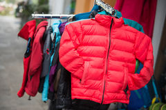 Down jacket for sell in clothing shop Royalty Free Stock Photos