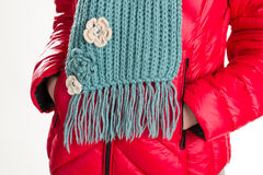 Down jacket and woolen scarf. Stock Images