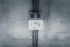 Down light. Down light on exposed concrete wall Royalty Free Stock Image