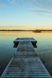 Down by the long wooden jetty Royalty Free Stock Photo