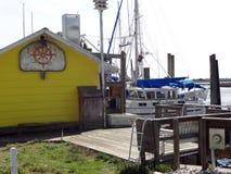 Down by the Marina in Southport, North Carolina. Yellow seafood shack on the marina in Southport, North Carolina (NC stock photo