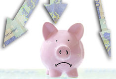 Down market. Frowning pink piggy bank down Euro arrows Royalty Free Stock Photos