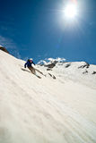 Down the mountain. Freerider in a mountains, Caucasus, summer, 2010 Royalty Free Stock Image