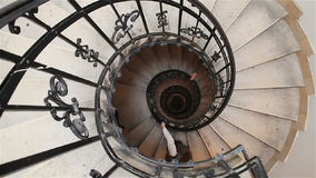 Down the old spiral staircase in the building stock video