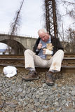 Down and Out Man on Railroad Tracks Royalty Free Stock Photo