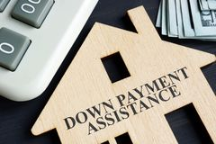 Free Down Payment Assistance Written On A Model Of Home Stock Photography - 140950712