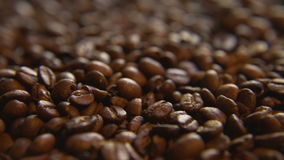 Down a Pile of Coffee Beans. Macro close up moving through lush a pile of roasted coffee beans stock video footage