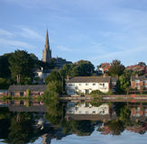 Down by the river. Shot taken of houses and church in Exeter England the reflections have been digitally manipulated Royalty Free Stock Image