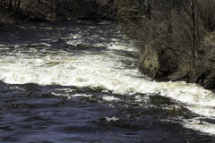 Down the River. Looking down the Grasse river rapids Royalty Free Stock Photo