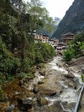 Down the river toward Aguas Caliente. The town of Aguas Caliente is located at the foot of Machu Picchu in a beautiful cloud forest royalty free stock photo
