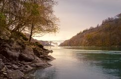 A down river view of Niagara Falls. And the Rainbow Bridge from the Gorge royalty free stock images