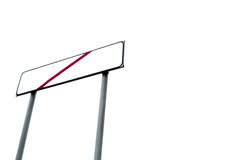 Down shot of empty signpost with crossed red line Royalty Free Stock Photo