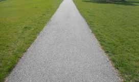 Down the sidewalk. View of the sidewalk narrowing in the distance Royalty Free Stock Images