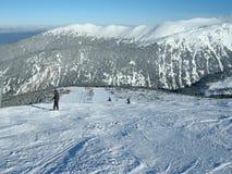 Down the Slope. Snowboarders on the ski slope in Bansko ski resort, mountain Pirin, Bulgaria Royalty Free Stock Image