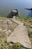Down stairs. Rock stairs, leading to a cliff on the beach. Harsova, Romania Stock Images