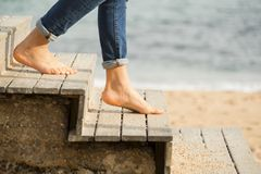 Down the stairs to the beach. Going down the stairs on the beach with bare feet down the stairs on the beach with bare feet Royalty Free Stock Image