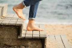 Down the stairs to the beach. Going down the stairs on the beach with bare feet down the stairs on the beach with bare feet Stock Photos