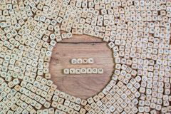 Down-Syndrom, German text for Down syndrome, word in letters on cube dices on table stock photo