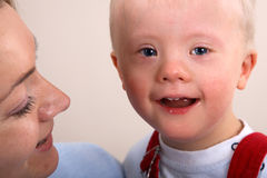 Down Syndrome boy and mother Royalty Free Stock Images