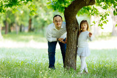 Down syndrome brother and adopted child playing outdoors Royalty Free Stock Photo