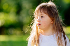 Down syndrome child in nature Stock Images